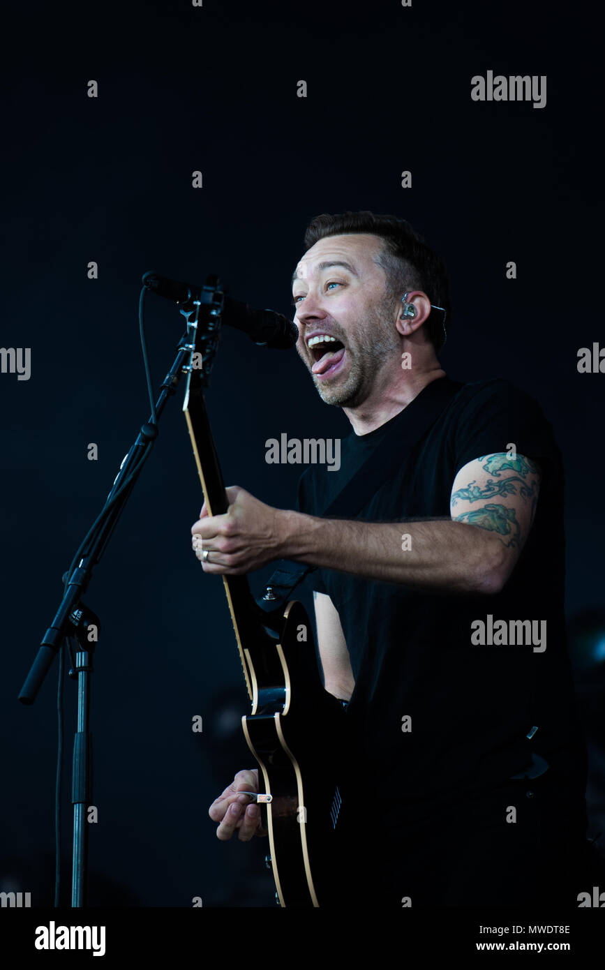 01 June 2018, Germany, Nuremberg: Singer Tim McIlrath of the band 'Rise Against' performs at the music festival 'Rock im Park', which runs until 03 June 2018. Photo: Nicolas Armer/dpa - Stock Image