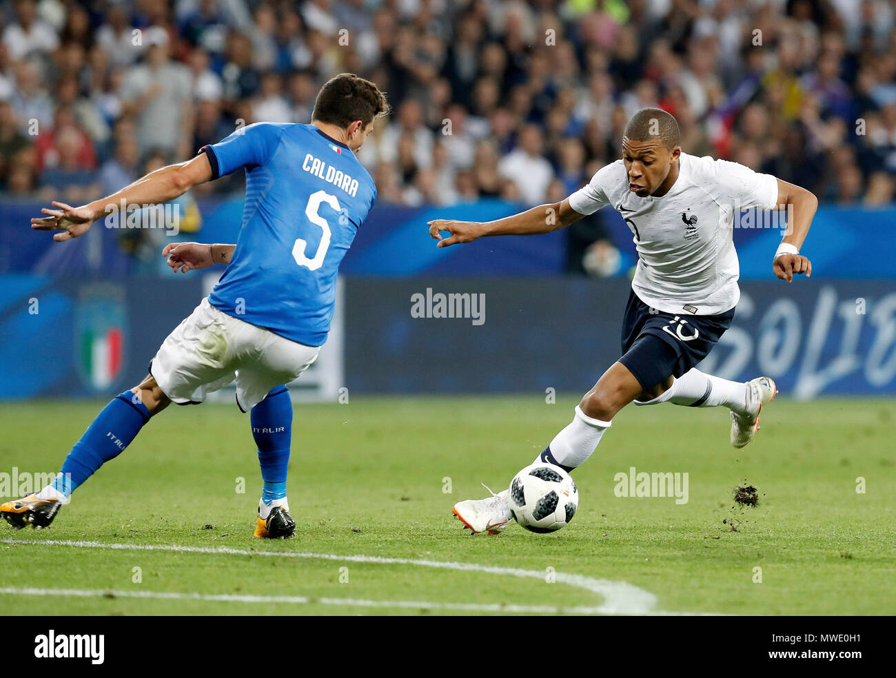 Nice, France.  1st June, 2018. Kylian Mbappe (R) of France competes with Mattia Caldara of Italy during a World Cup warm-up in Nice, France on June 1, 2018. France won 3-1. Credit: Federico Simoni/Xinhua/Alamy Live News - Stock Image