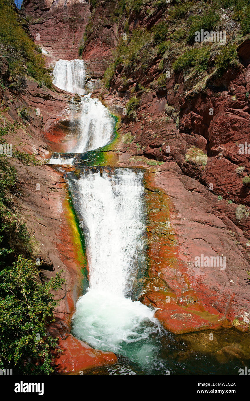 MULTI-STEP WATERFALLS WITH PLUNGE POOL IN A RED ROCK SCENERY. Vallon de Challandre, French Riviera's hinterland, France. - Stock Image