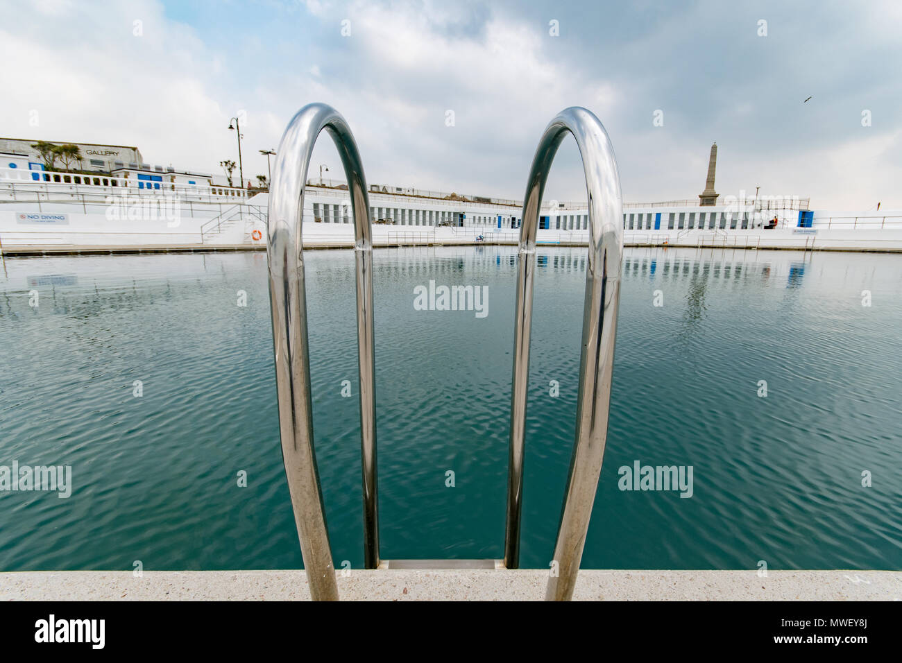 Penzance outdoor Jubilee Pool as seen from behind shiny steps - Stock Image