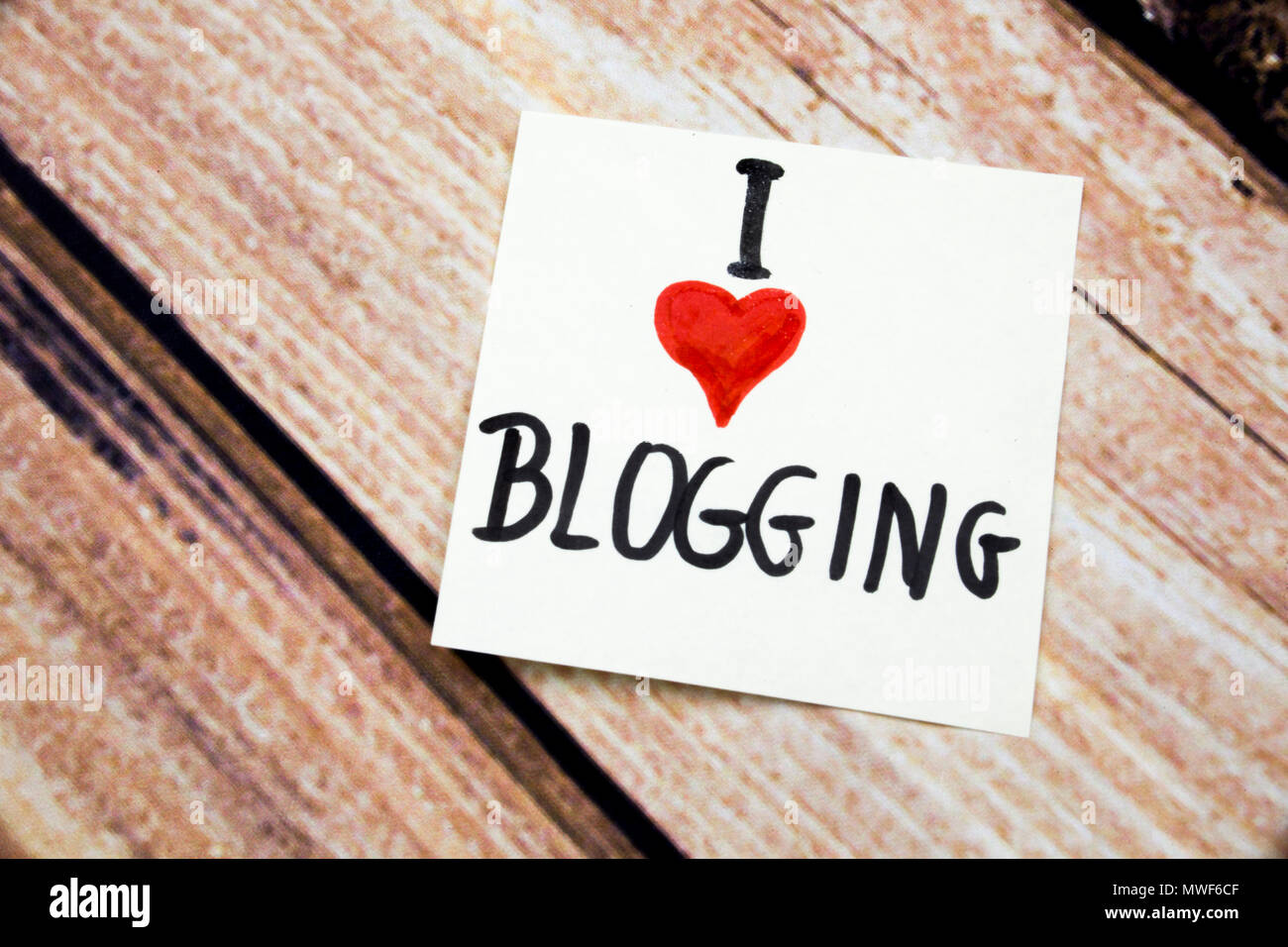 I Love Blogging Message With Red Heart Symbol On The White Paper