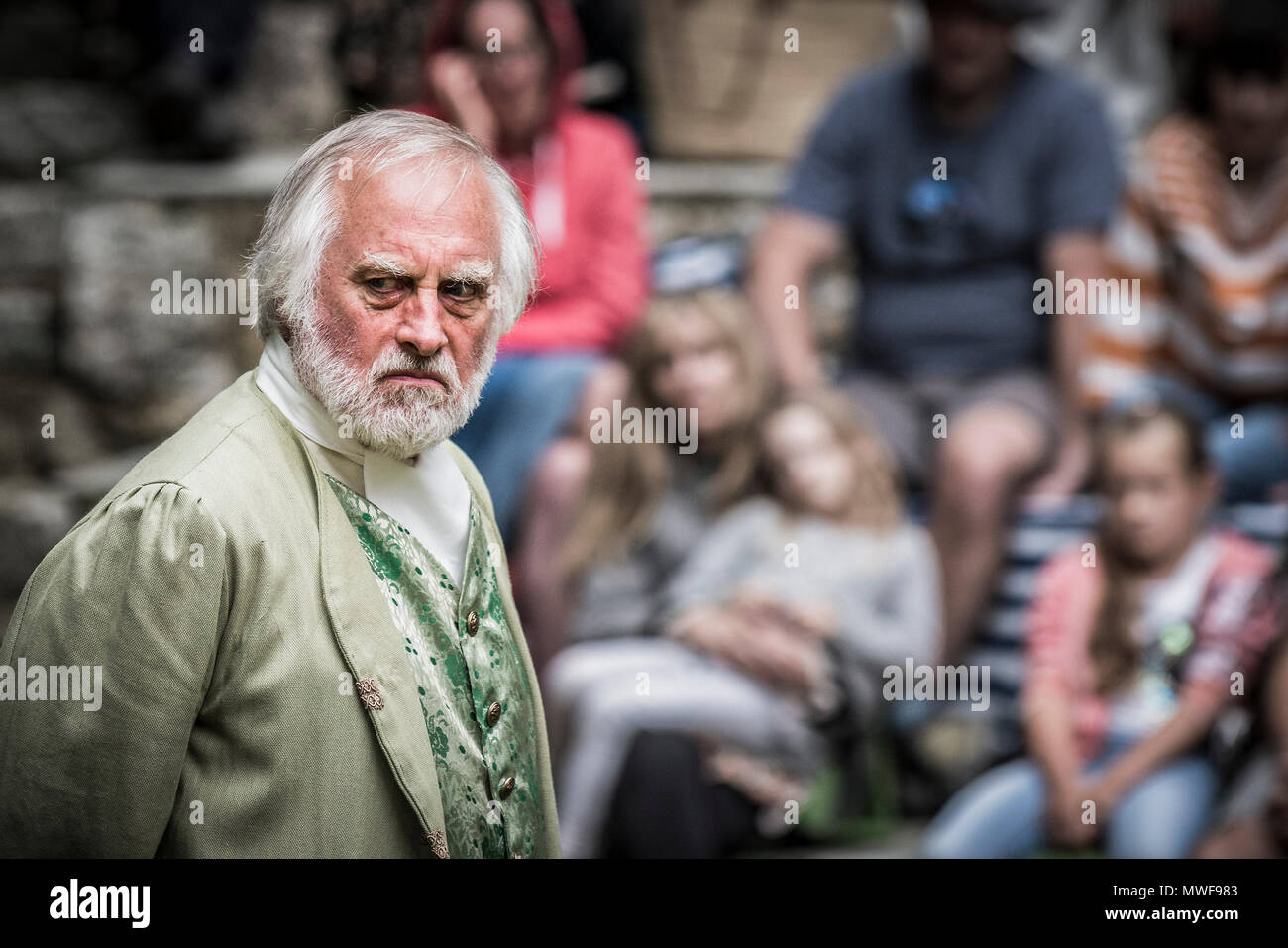 Acting - An amateur drama group in a performance at Trebah Garden Amphitheatre in Cornwall. - Stock Image