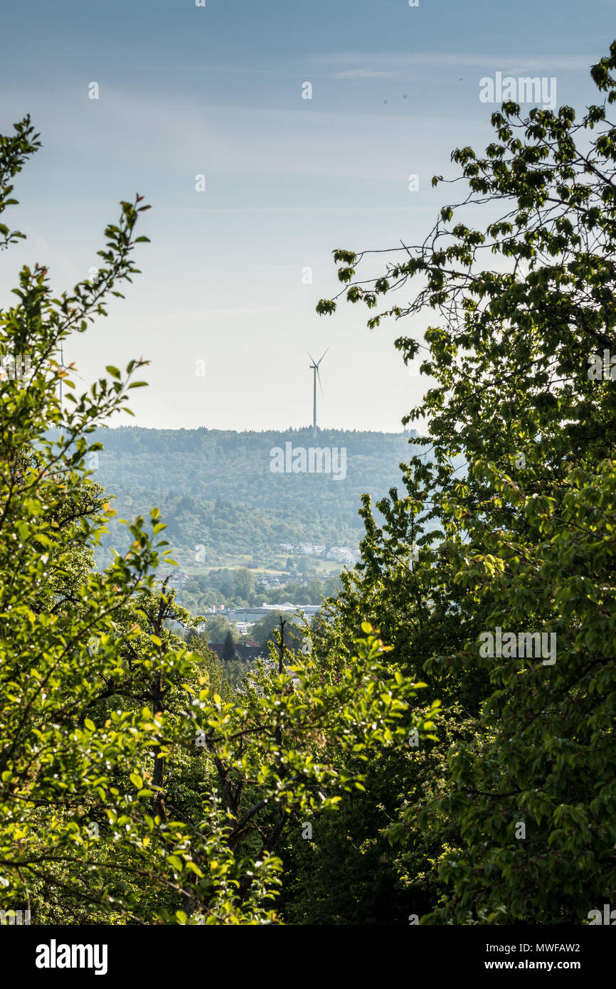 Big windmills for wind power near the village - Stock Image
