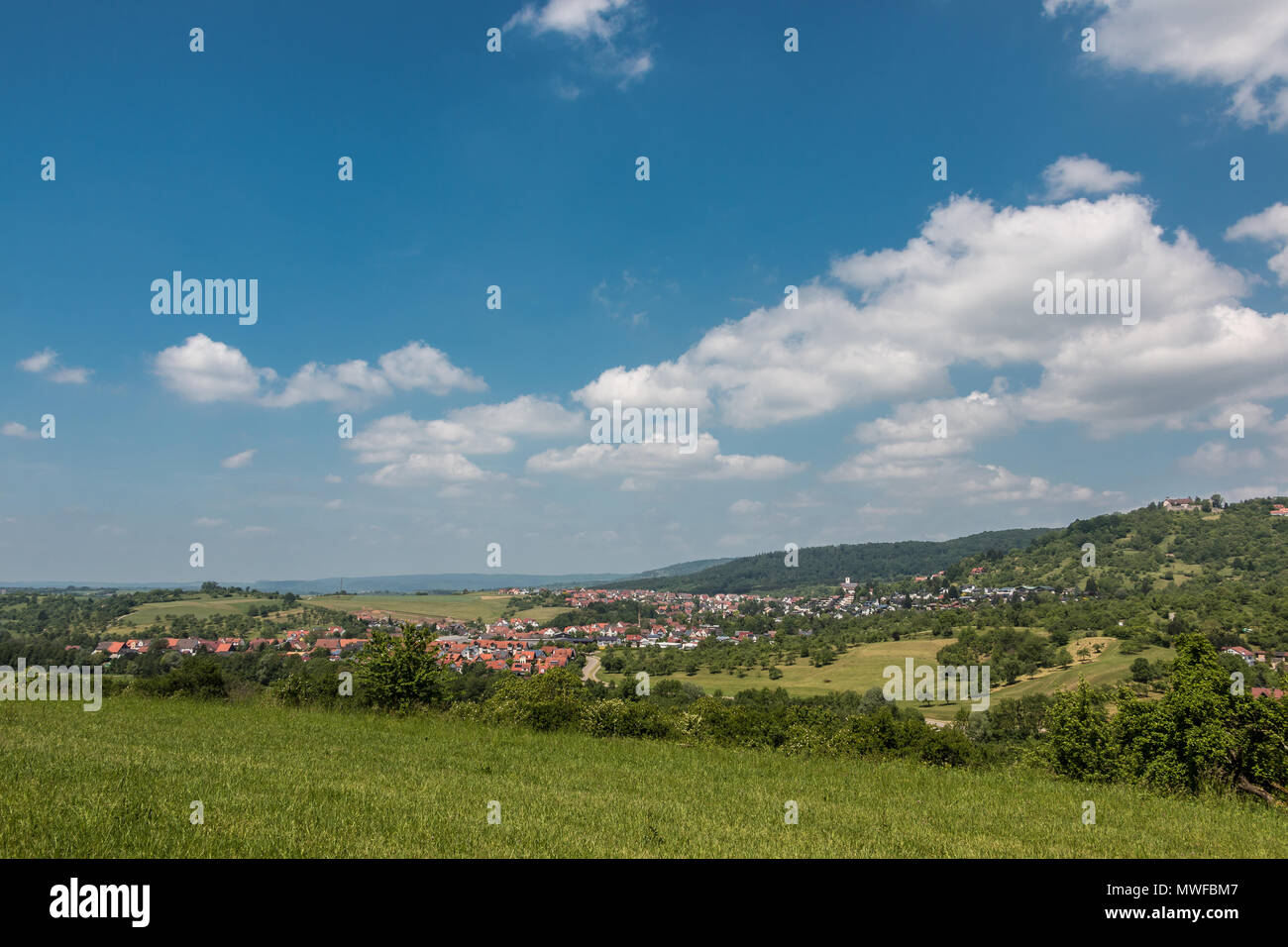Little village in the middle of the german countryside with forests, fields and meadows - Stock Image