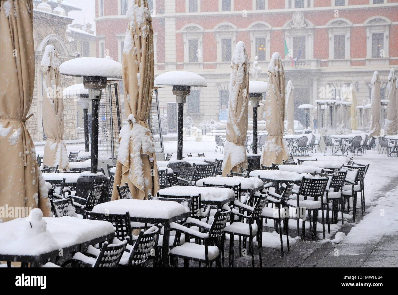 Outside Bar Tables Covered With Snow. Brescia, Italy