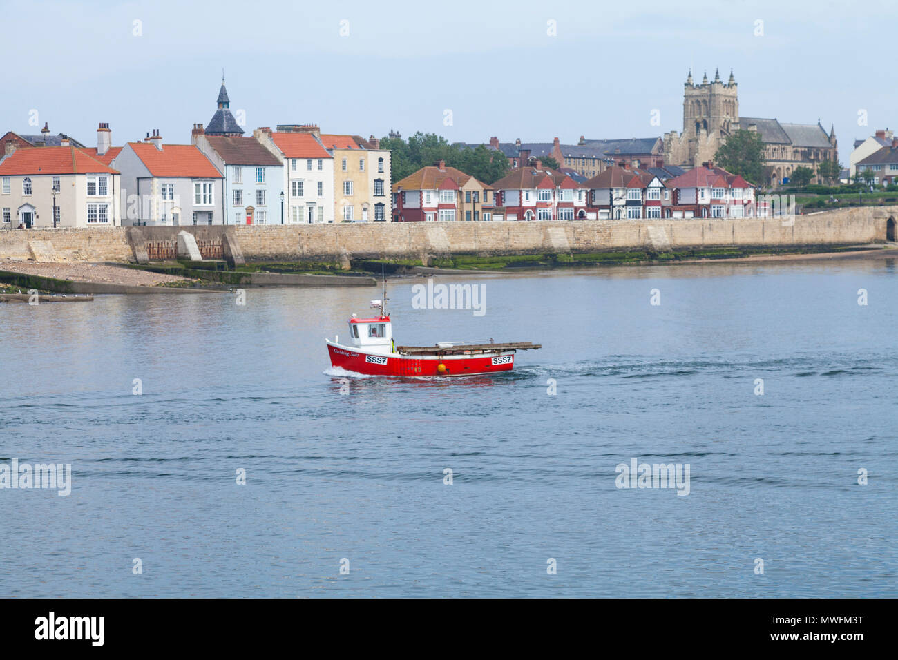 The headland at Old Hartlepool,England,UK with the Guiding Star boat heading into the port - Stock Image