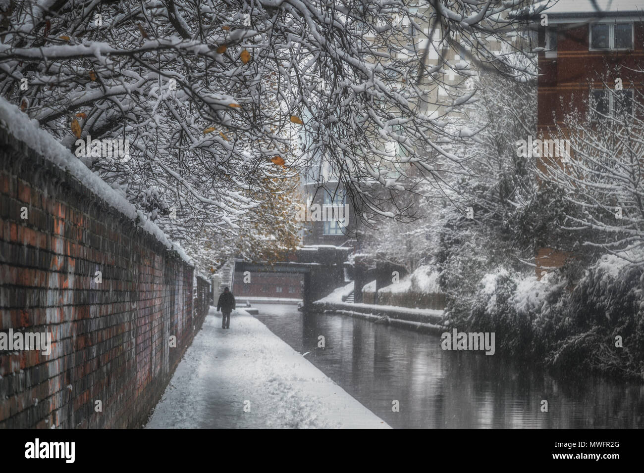A snow storm hits Gas Street and the canals that lead into the basin. - Stock Image