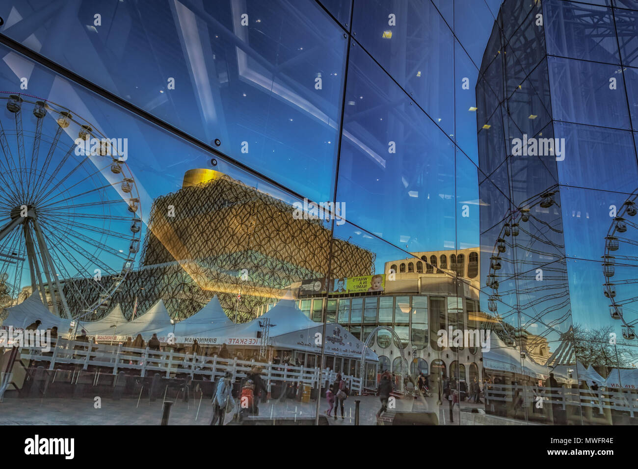 Reflection of Centenary Square in the Symphony Hall building in Birmingham - Stock Image