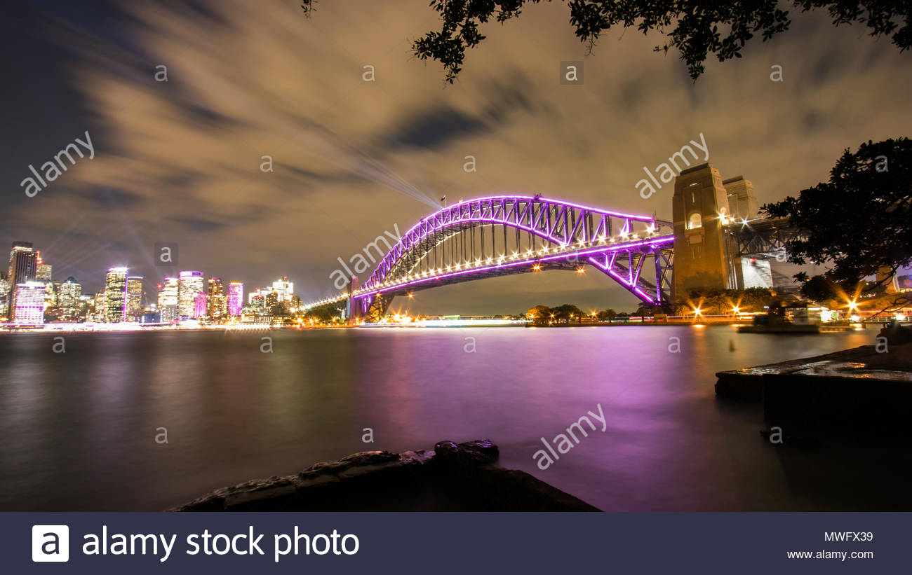 Sydney Harbour Bridge and Skyline. Illuminated by the Vivid Festival lights. 2018. - Stock Image
