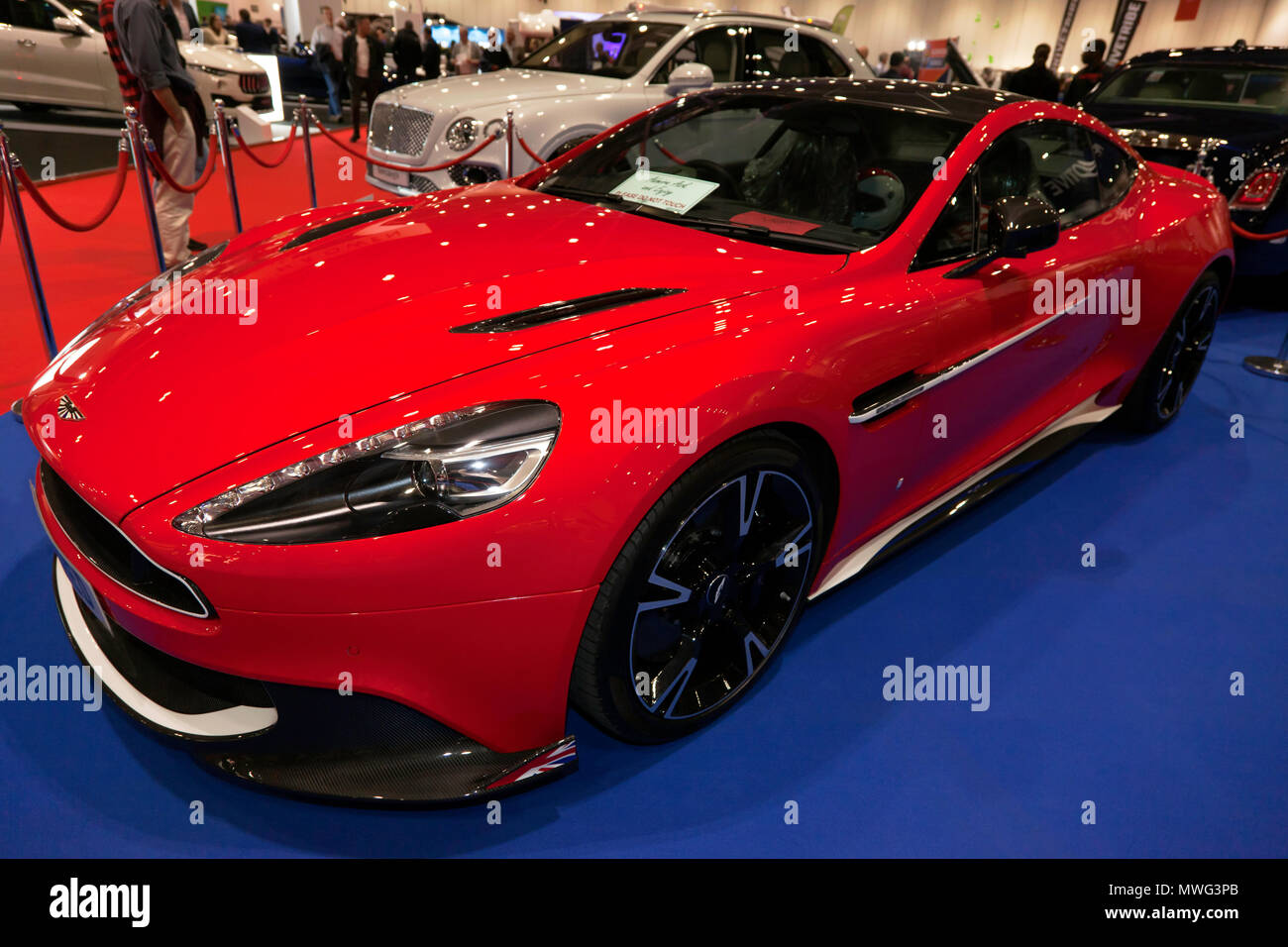 Three-quarter front view of, one of the,  Red Arrows Edition Aston Martin Vanquish S, on the RAF Benevolent Fund Stand, at the 2018 London Motor Show - Stock Image