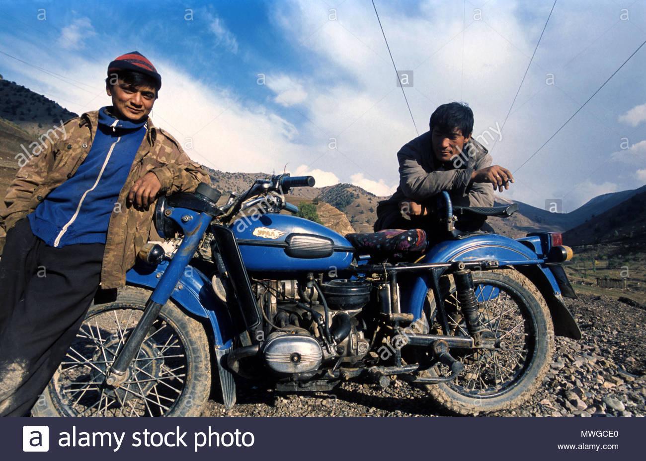 Uzbekistan, young boys with an old soviet motor bike Stock Photo