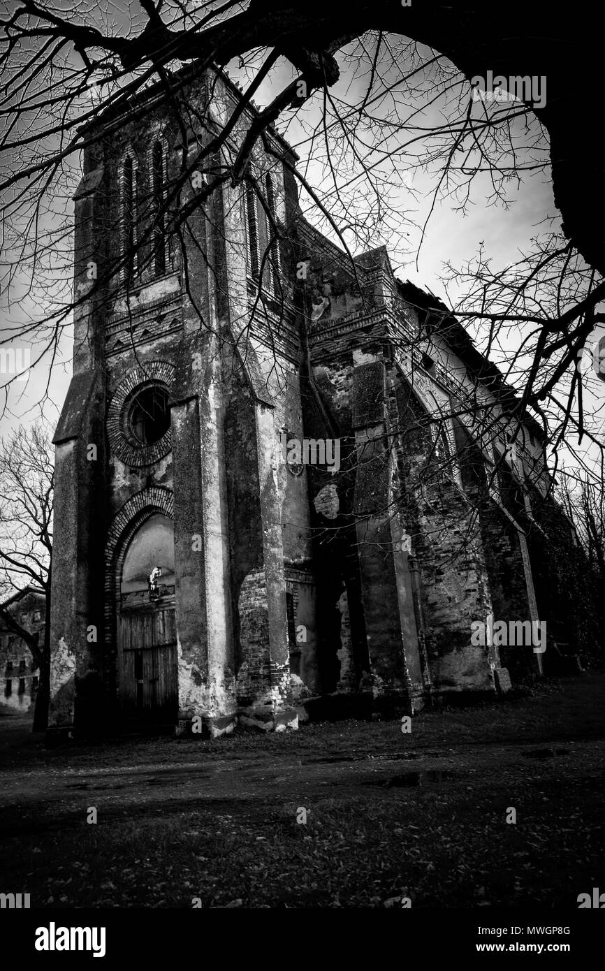 Creepy abandoned Catholic church - Stock Image