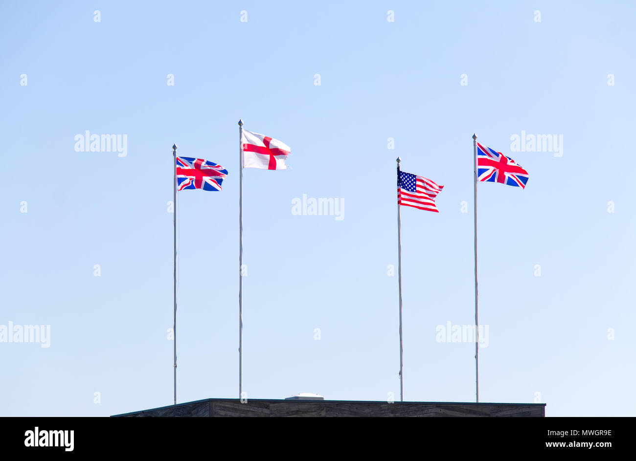 Union Jack, George cross and the Stars and Stripes flying to celebrate the royal wedding of Prince Harry and Meghan Markle Stock Photo