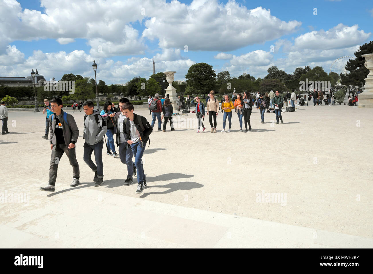 A group of students walking along a path in a park in Paris, France   KATHY DEWITT - Stock Image