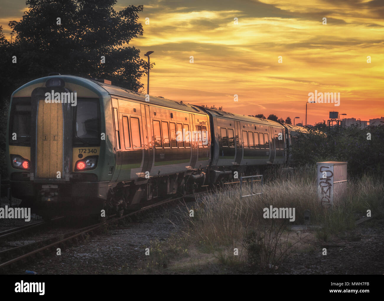 Sunset over the city of Birmingham from Tyseley train station - Stock Image