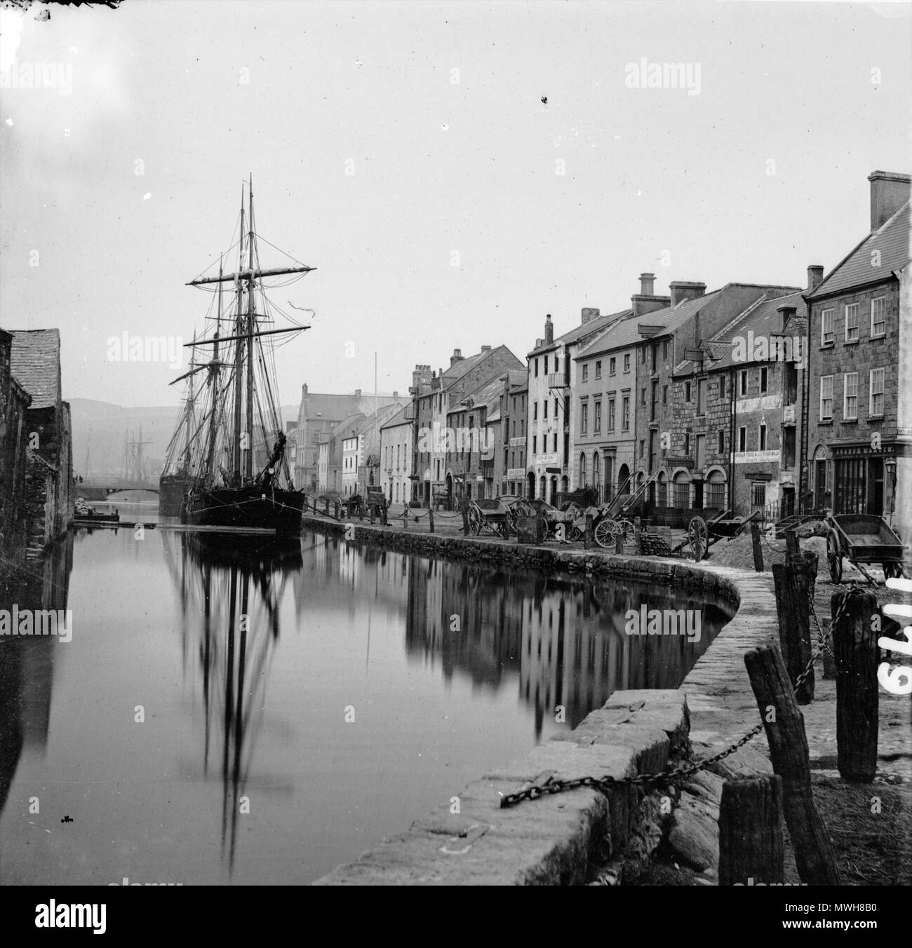 . English: Ships on the canal at Merchants Quay in Newry, alongside a nice brace of merchants' premises. Date: 1870s? (but definitely between 1860 and 1883) . 1870. Anonymous 412 Merchants Quay, Newry - Stock Image