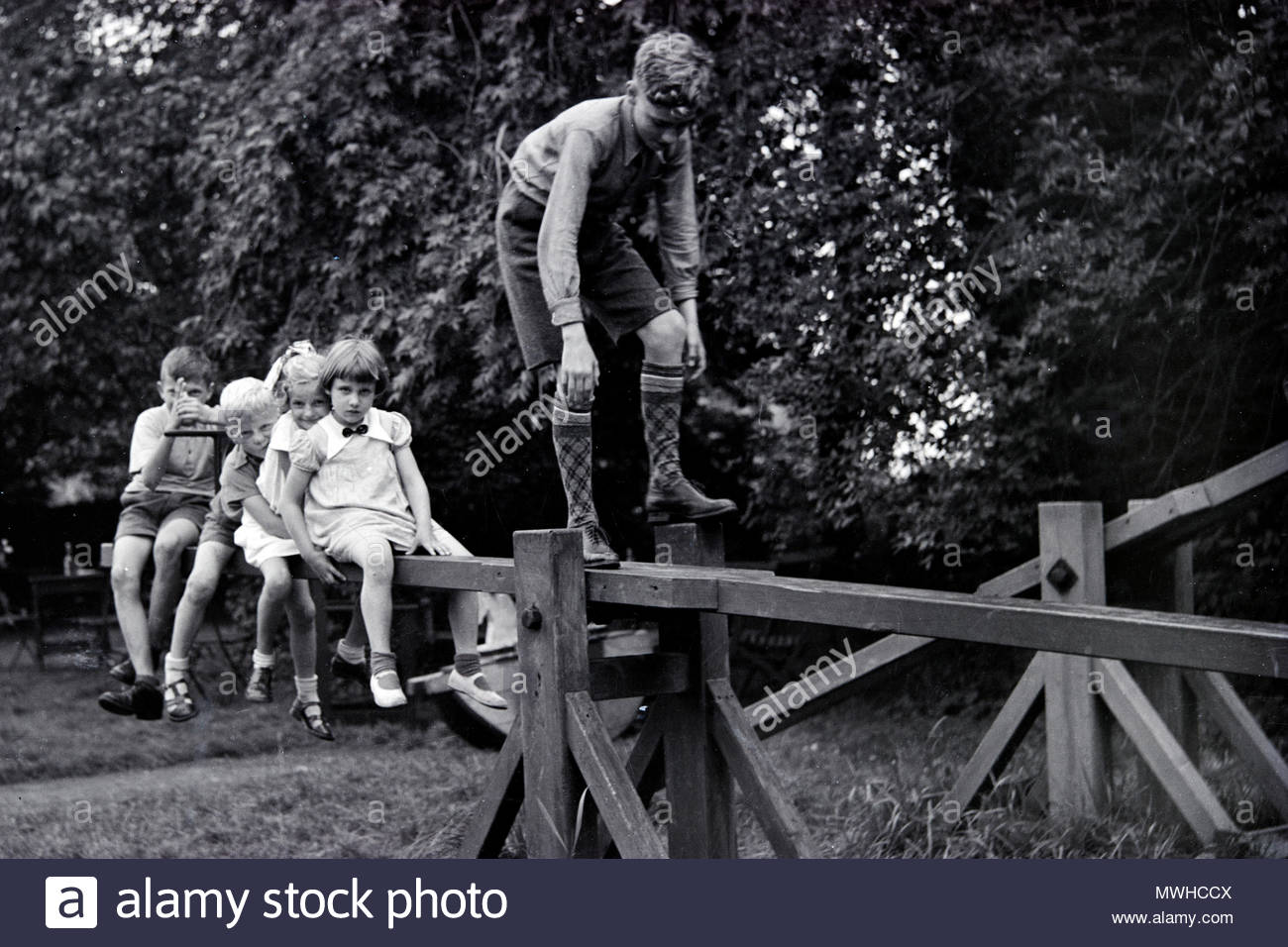 group of children playing on a large seesaw Netherlands 1950s - Stock Image