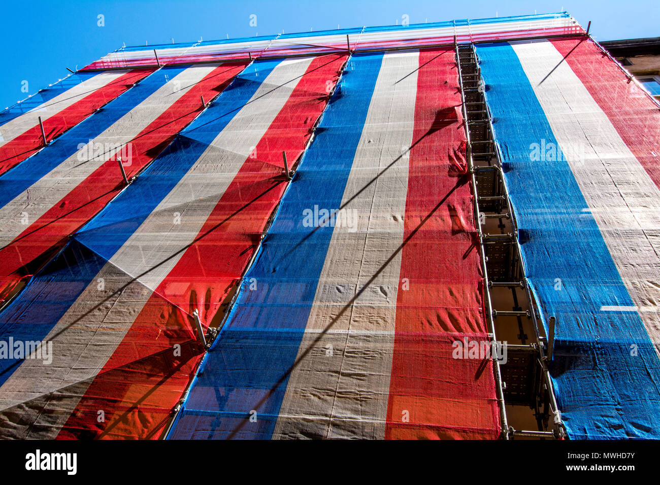 Color of French flag on a scaffolding. France - Stock Image