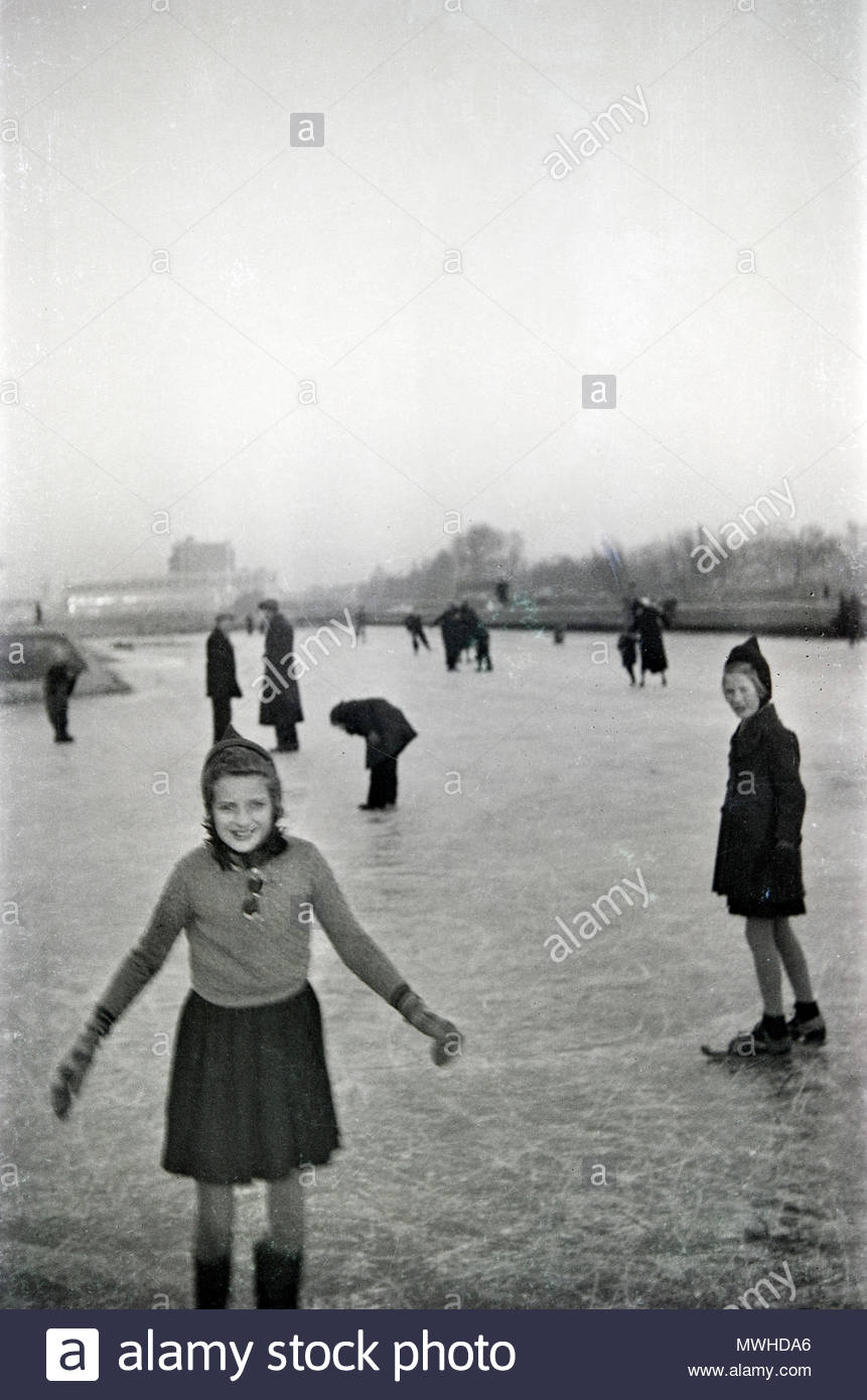 people ice skating 1950s Netherlands - Stock Image
