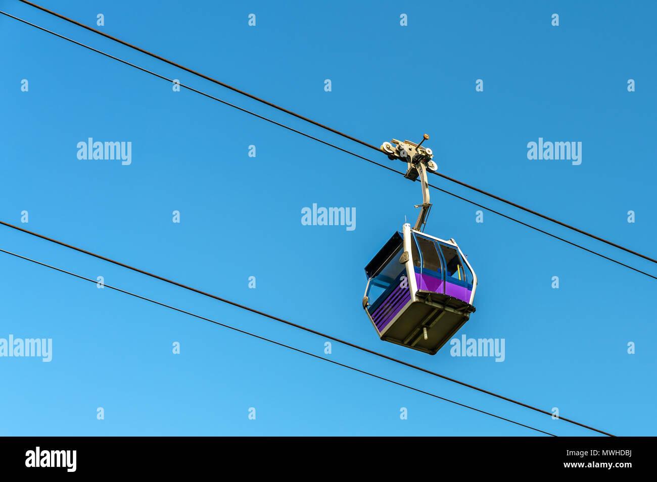 Gondola of Ngong Ping 360 cable car above Lantau Island in Hong Kong - Stock Image