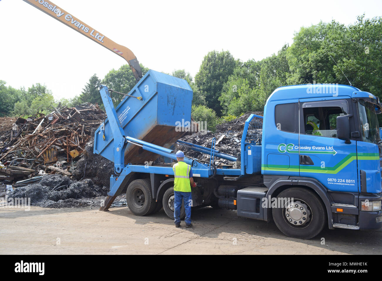 lorry driver tipping load of scrapyard leeds yorkshire united kingdom - Stock Image
