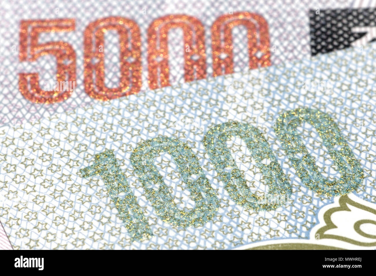 Detail from North Korean banknotes showing 1000 and 5000 in reflective raised ink - Stock Image