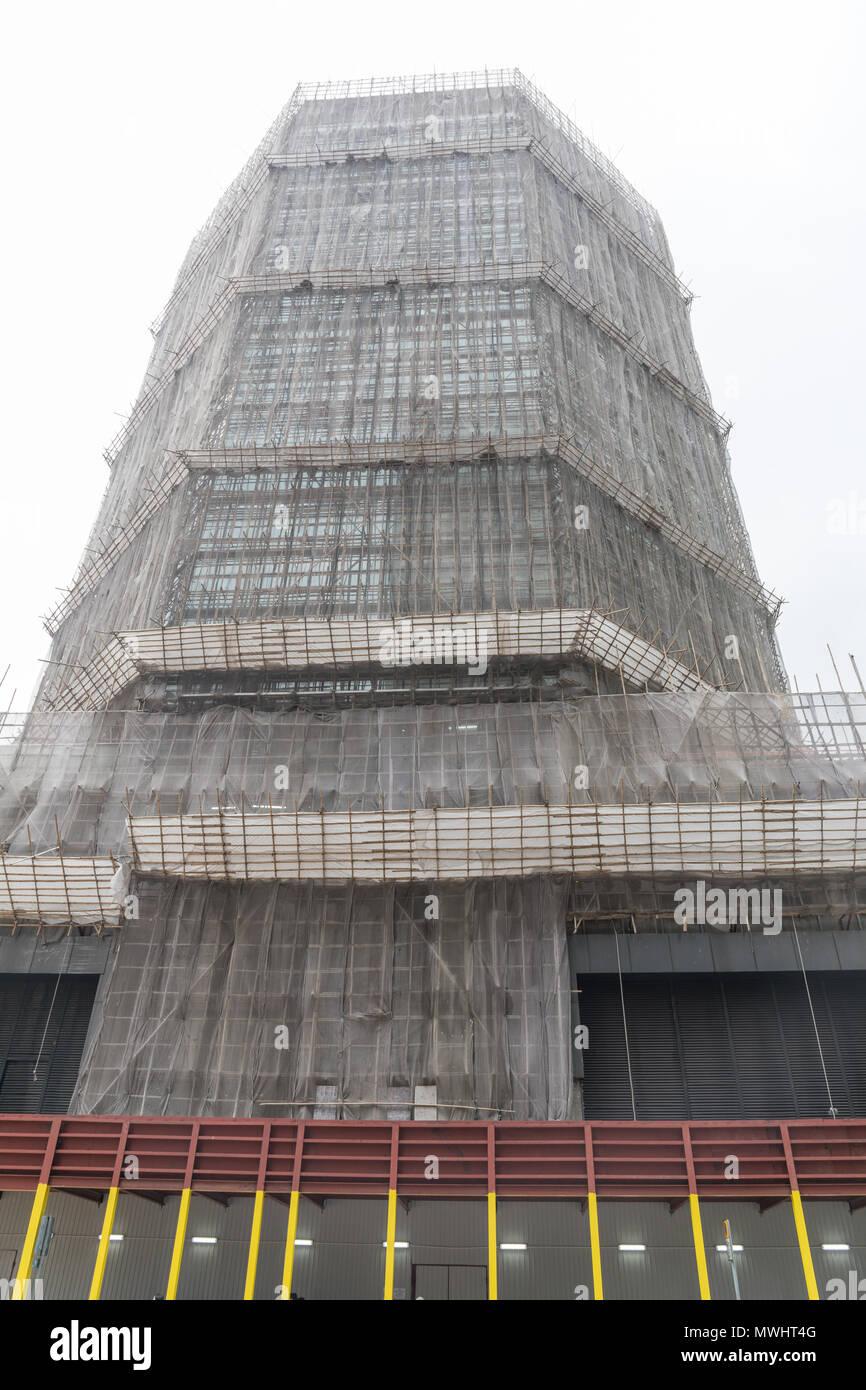 Bamboo Scaffolding at Skyscraper in Hong Kong - Stock Image