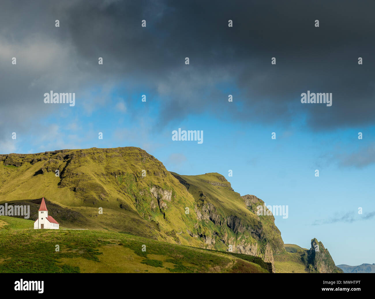 the iconic small church of Vik. Placed on hill above town it's placed in a beautiful setting. - Stock Image
