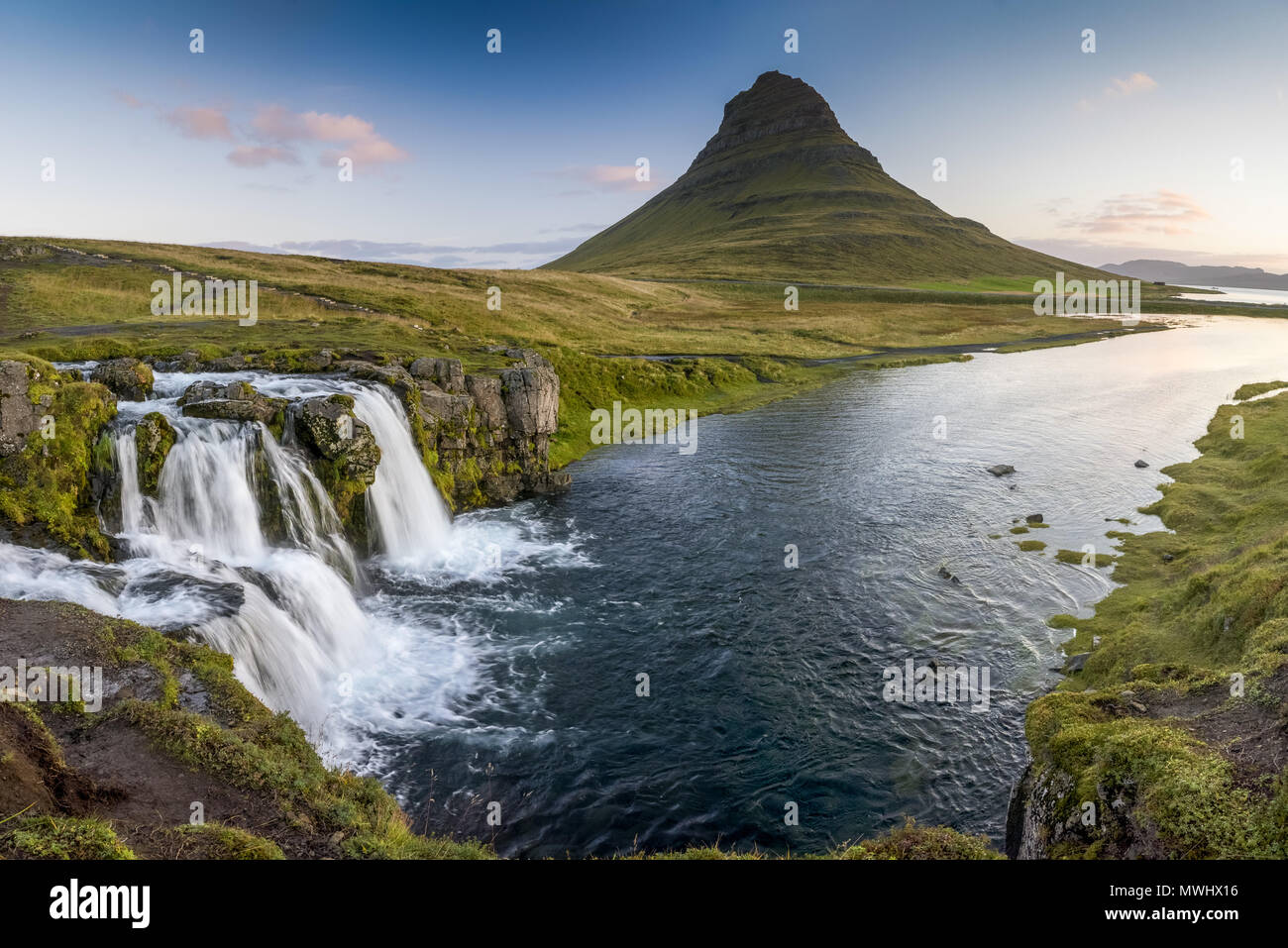 Kirkjufell and Kirkjufellsfoss near Grundafjördur in Northern Iceland - Stock Image