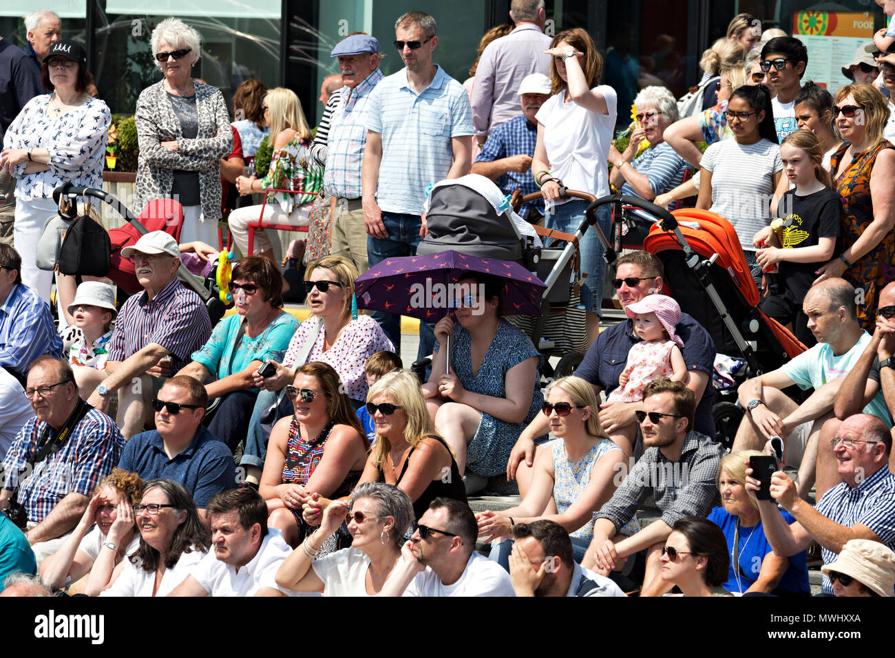 A lady using an umbrella as a sunshade during the recent May hot weather - Stock Image