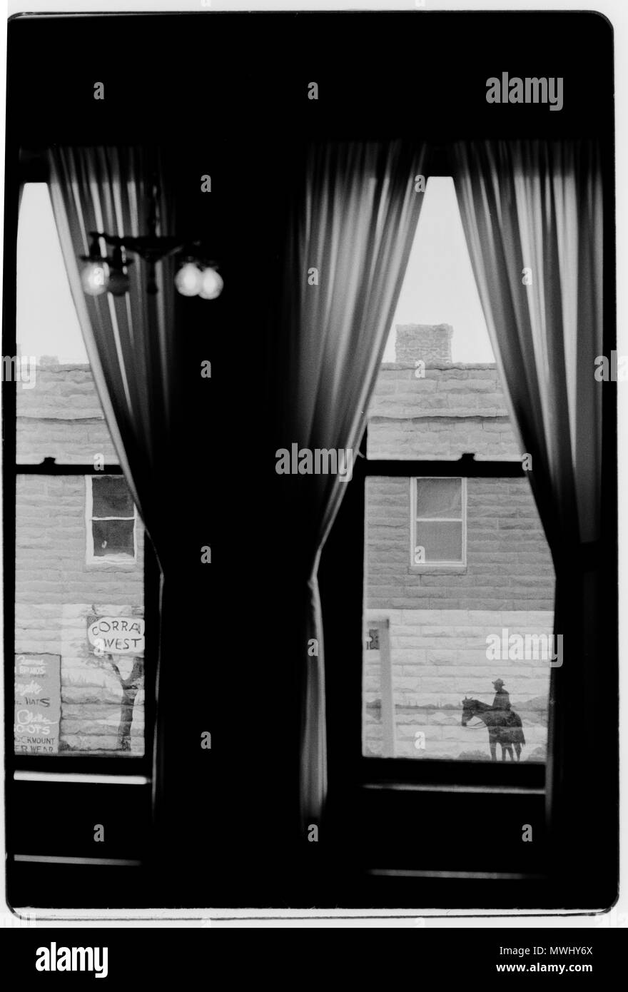 Wyoming USA View through a window to  man on a horse in Sheridan,Wyoming - Stock Image