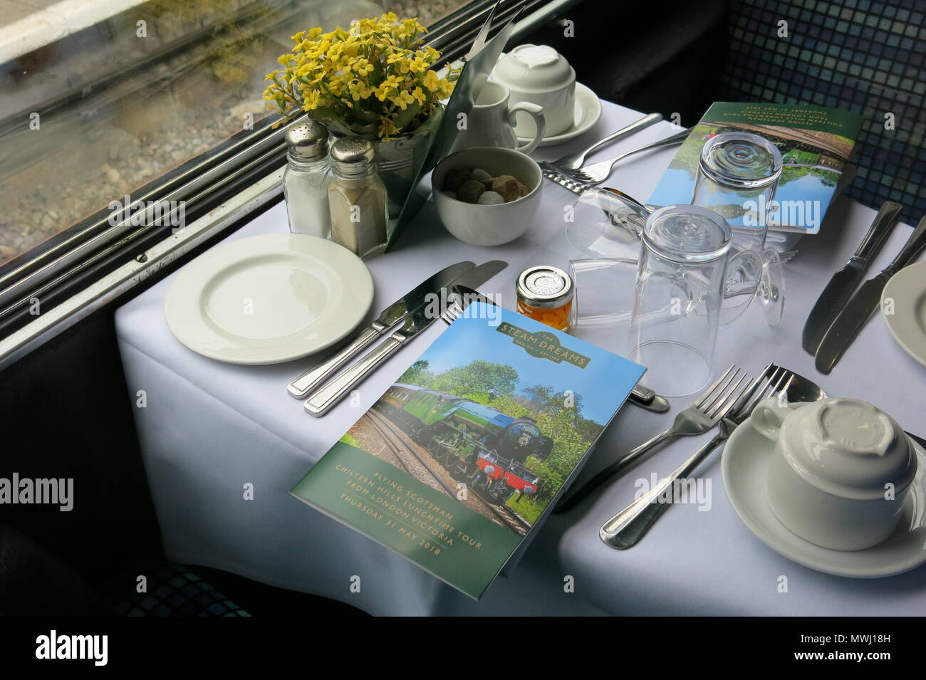 The table is laid for fine dining on the iconic Flying Scotsman for the steam-hauled Tour of the Chilterns operated by Steam Dreams on 31 May 2018 - Stock Image