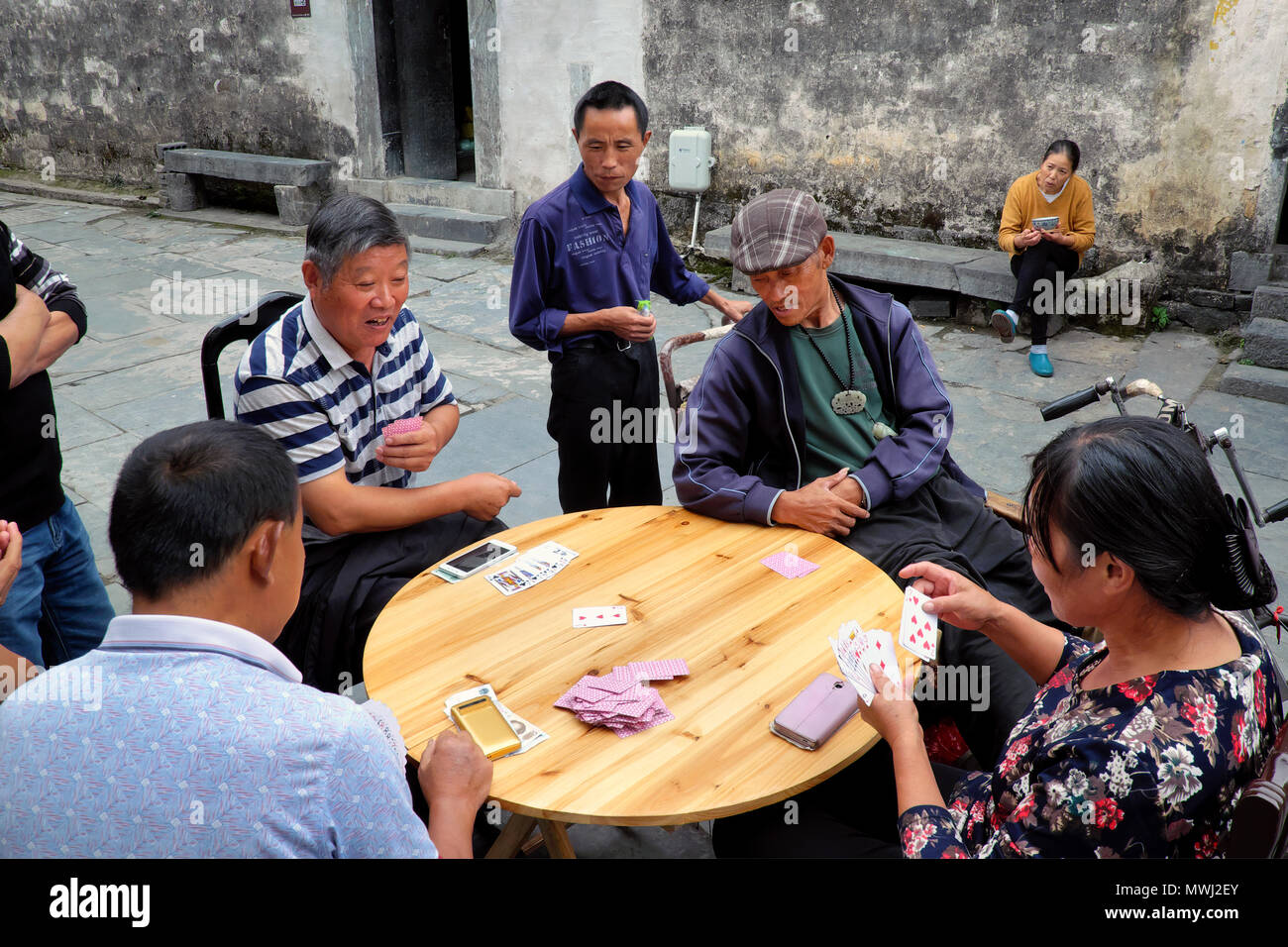 Game of cards on a brand new table, Xidi Ancient Village, Anhui Province, China - Stock Image