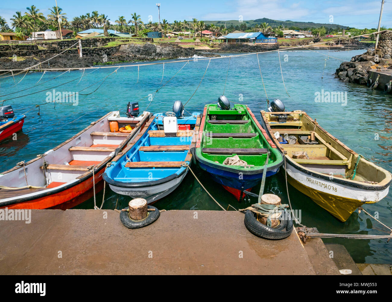 Colourful small open wooden boats tied up in harbour, Hanga Roa, Easter island, Rapa Nui, Chile - Stock Image