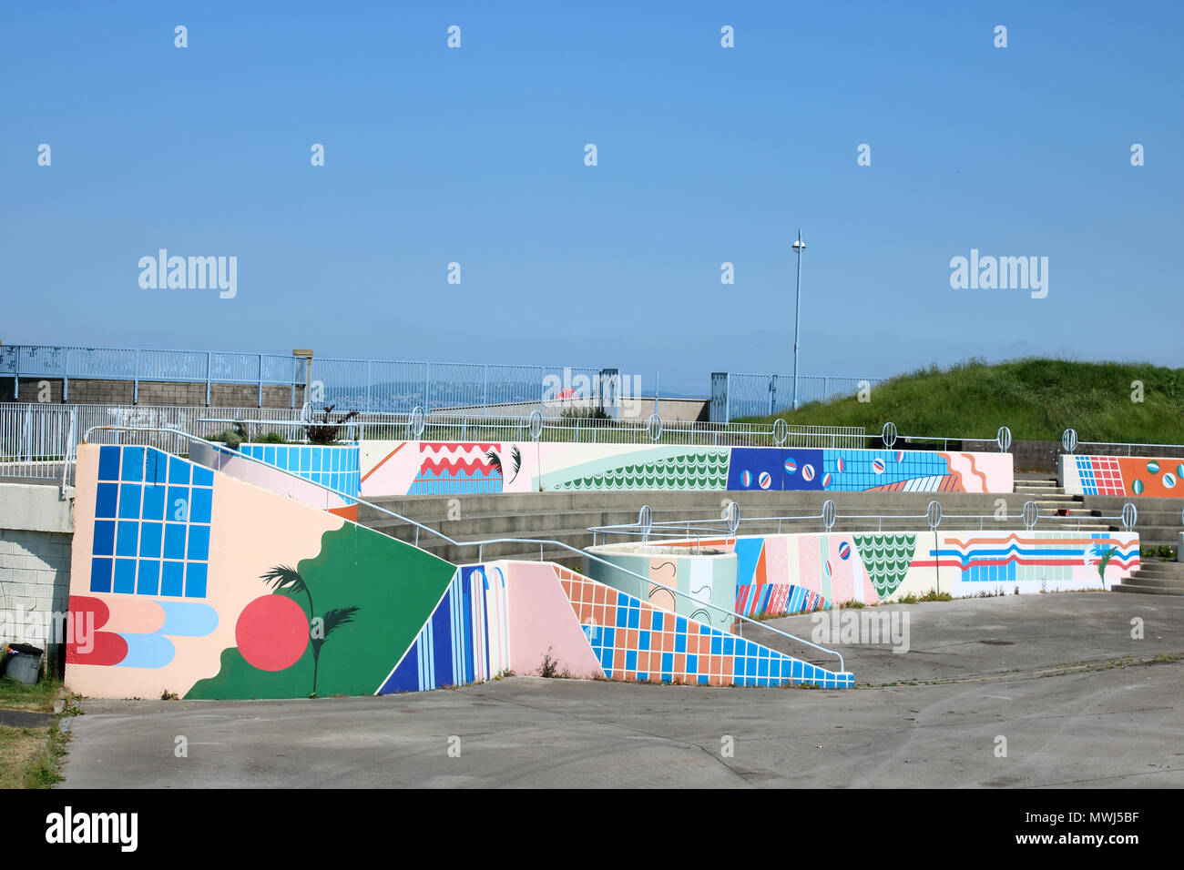 Mural type paintings of colourful patterns on walls at the former Dome and Bubbles site on Morecambe promenade, Morecambe, Lancashire, England. - Stock Image
