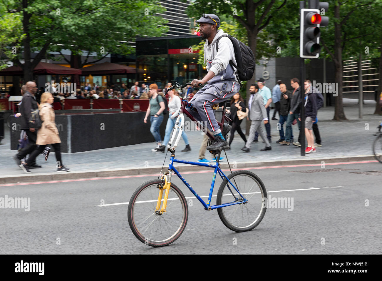 LONDON, UK - MAY 24, 2018 : A man riding a 'double-decker' custom made bicycle in the London Bridge area. - Stock Image