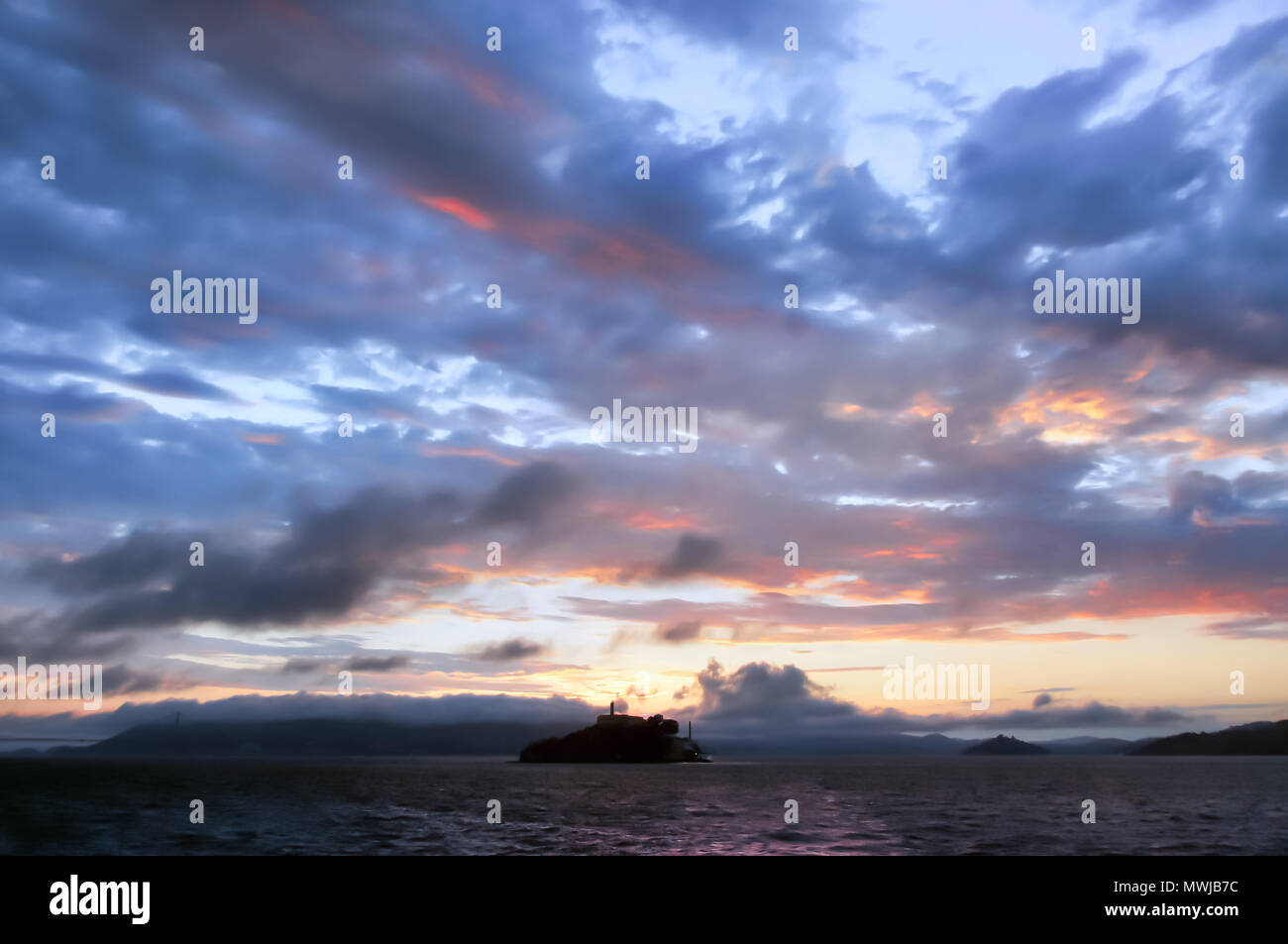 Alcatraz Island Sunset as seen from a Cruise Boat. - Stock Image