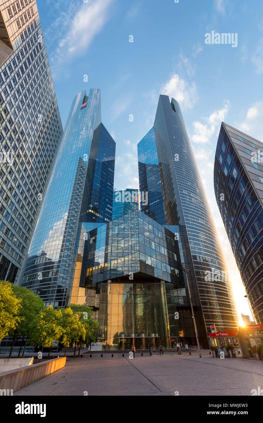 Setting sunlight over the financial district and modern architecture of La Defense, Paris France - Stock Image