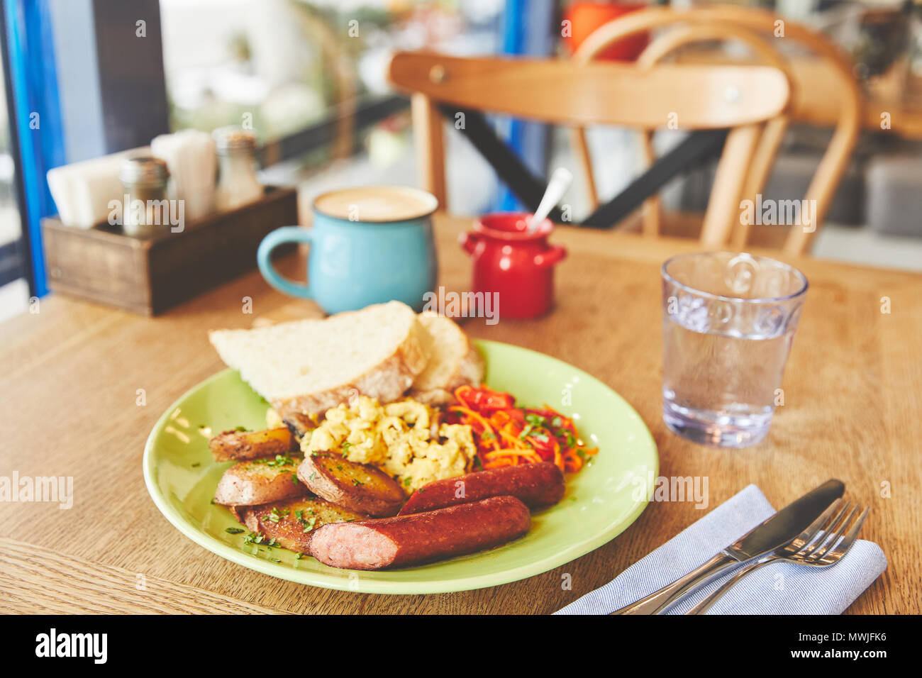 Brunch in restaurant with scramble eggs and coffee - Stock Image