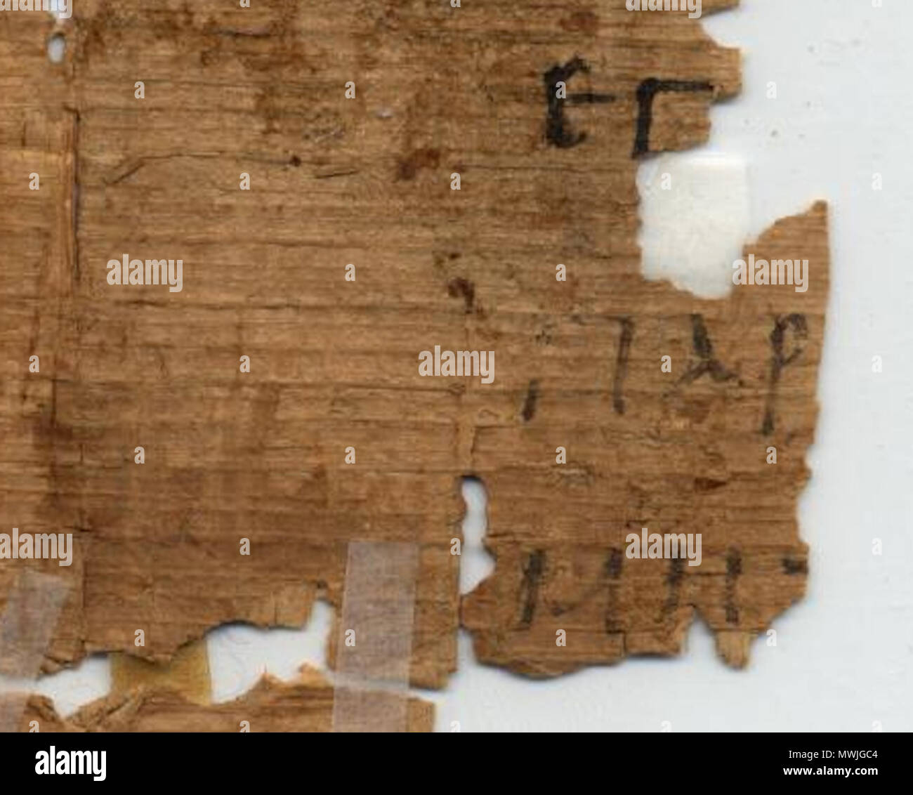 . English: Papyrus 1, flyleaf εγεν̣[ παρ[ μητ̣[ The text is very fragmentary, but probably says something about Jesus being born by Mary. 3rd century. Unknown 467 Papyrus 1 - flyleaf - Stock Image
