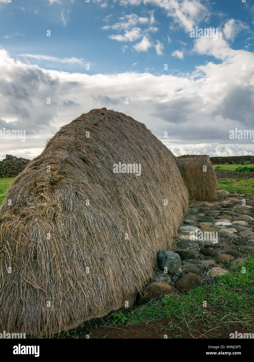Reconstructed traditional thatched boat shaped house called Hare Paenga, Akahanga, Easter Island, Rapa Nui, Chile - Stock Image