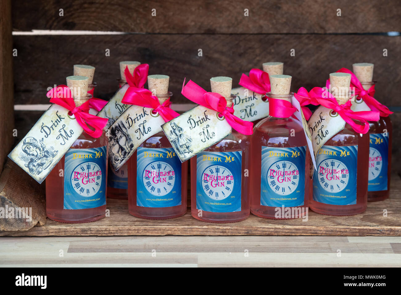 Speciality drink me rhubarb gin bottles at a food festival. Oxfordshire, England - Stock Image