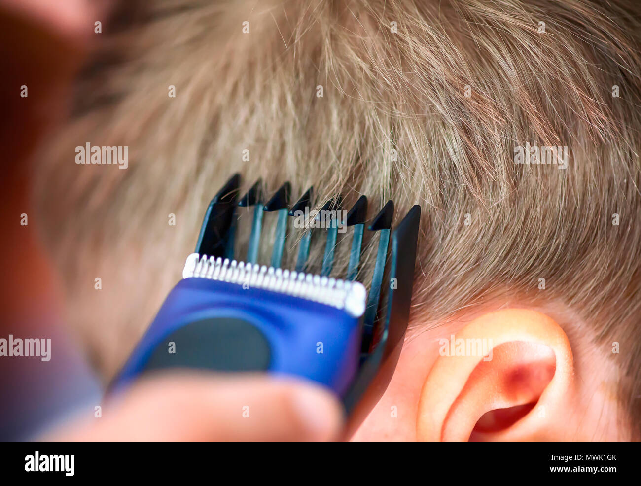 Child Haircut with Hairclipper. Close-up. - Stock Image