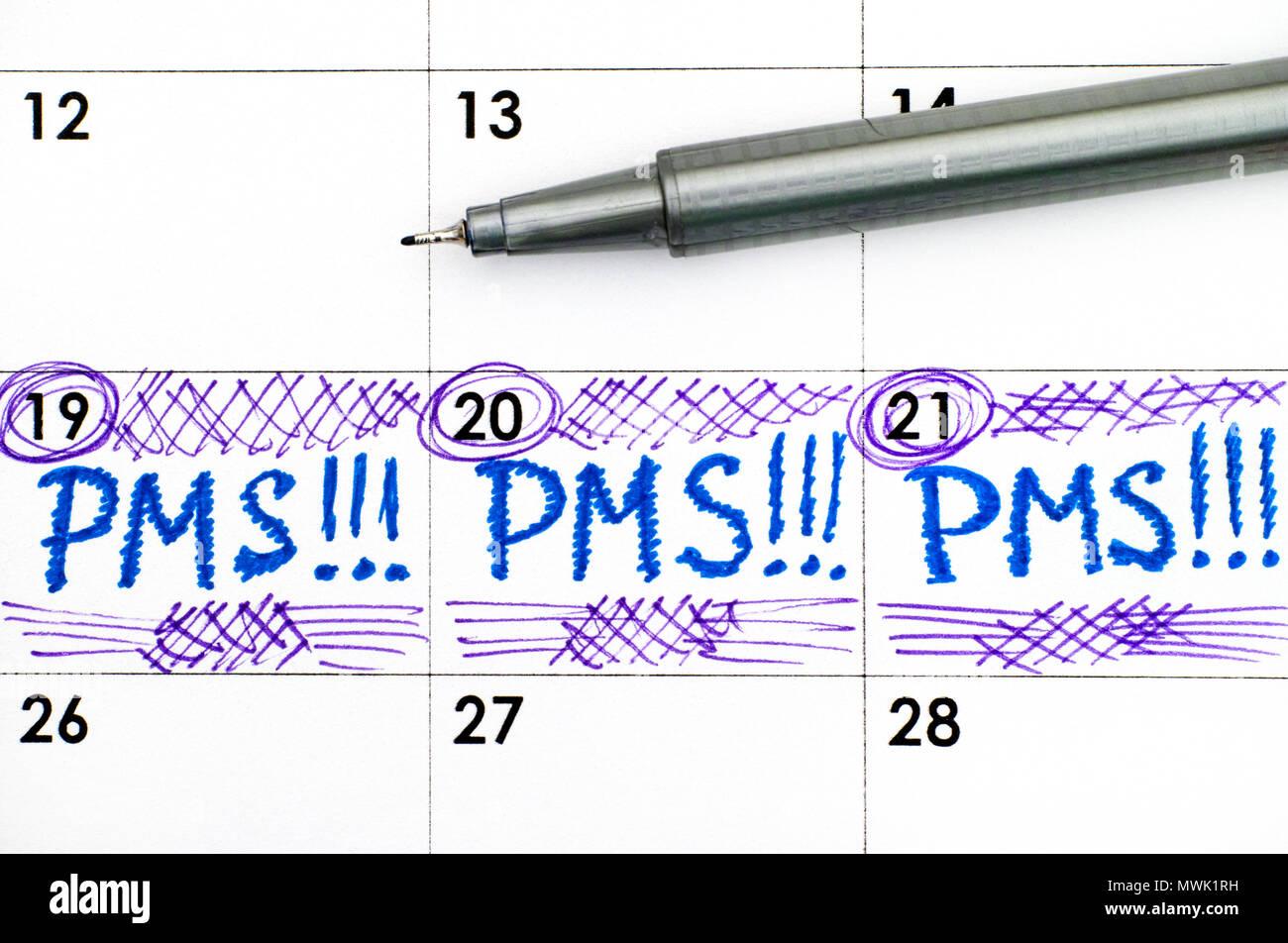 Reminder PMS in calendar with pen. Closeup. Stock Photo