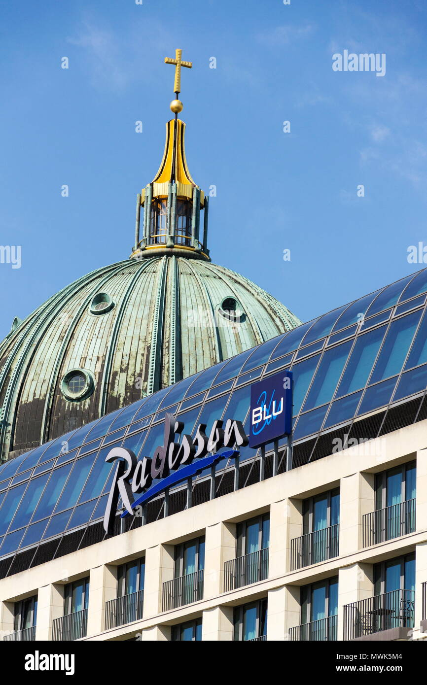 BERLIN, GERMANY - MAY 15 2018: Radisson Blu hotels and resorts logo on the building of hotel with Berlin Cathedral, Berliner Dom in background on May  - Stock Image