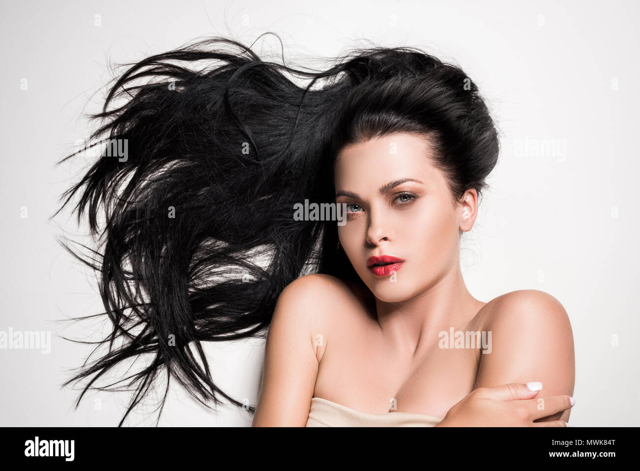 attractive woman with beautiful composed hair isolated on white - Stock Image