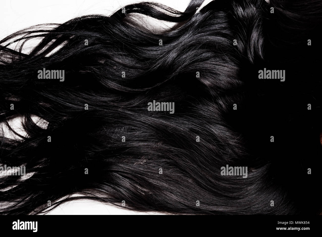 beautiful glossy brunette hair isolated on white - Stock Image
