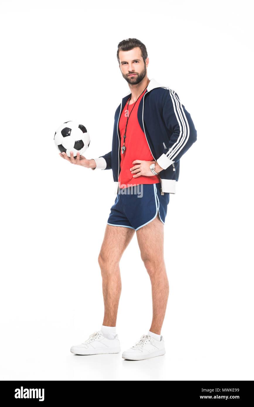 6b1380ba6 bearded soccer coach holding ball, isolated on white - Stock Image