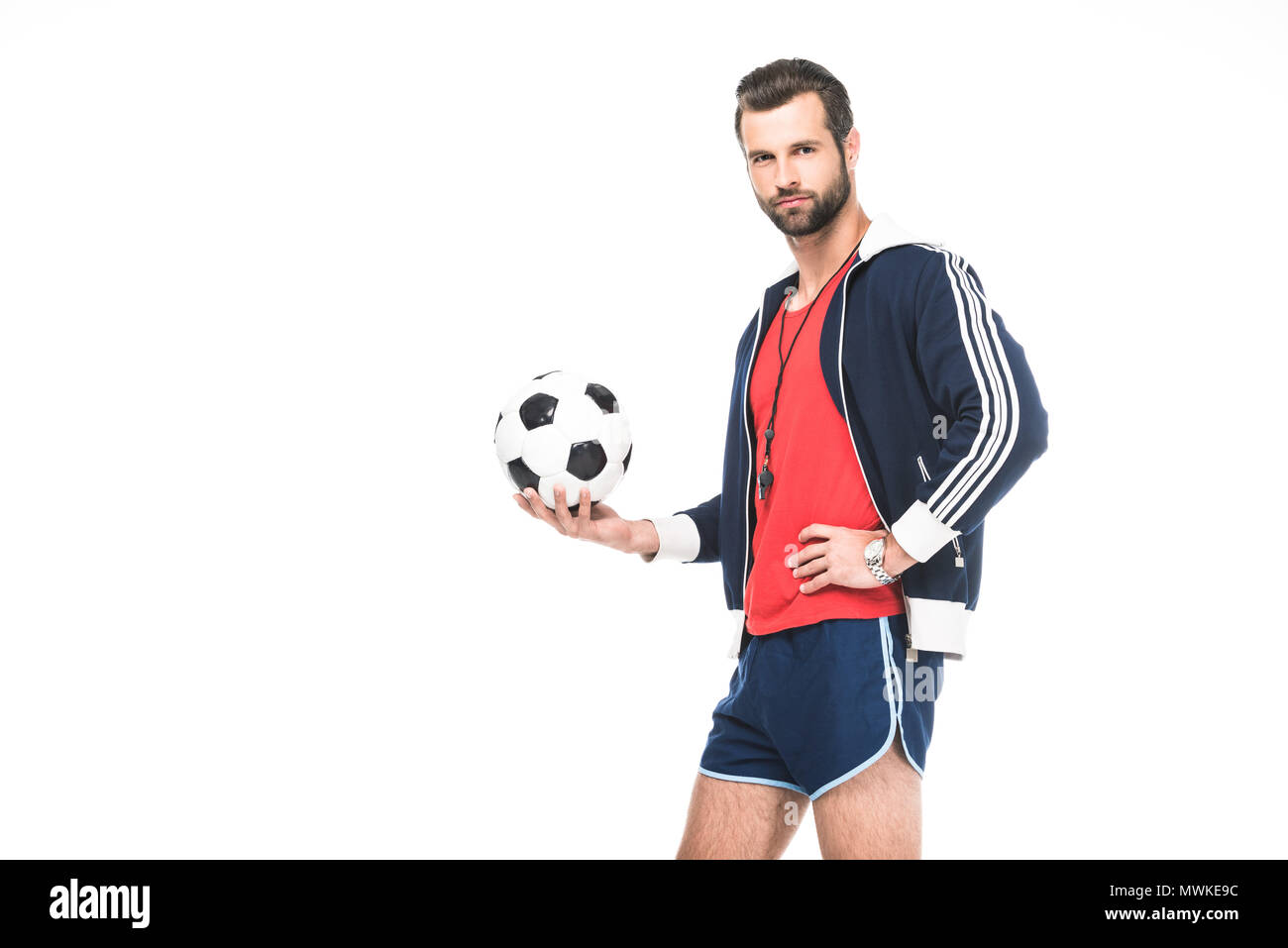 cf4d79bc4 bearded soccer trainer holding ball, isolated on white - Stock Image