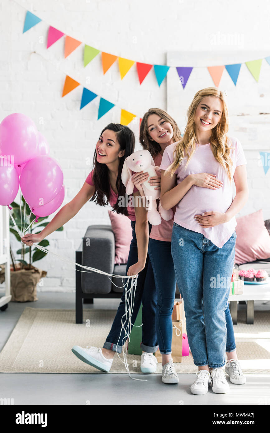 Happy Multicultural Friends And Pregnant Woman Posing With Rabbit Toy At Baby Shower Party Stock Photo Alamy